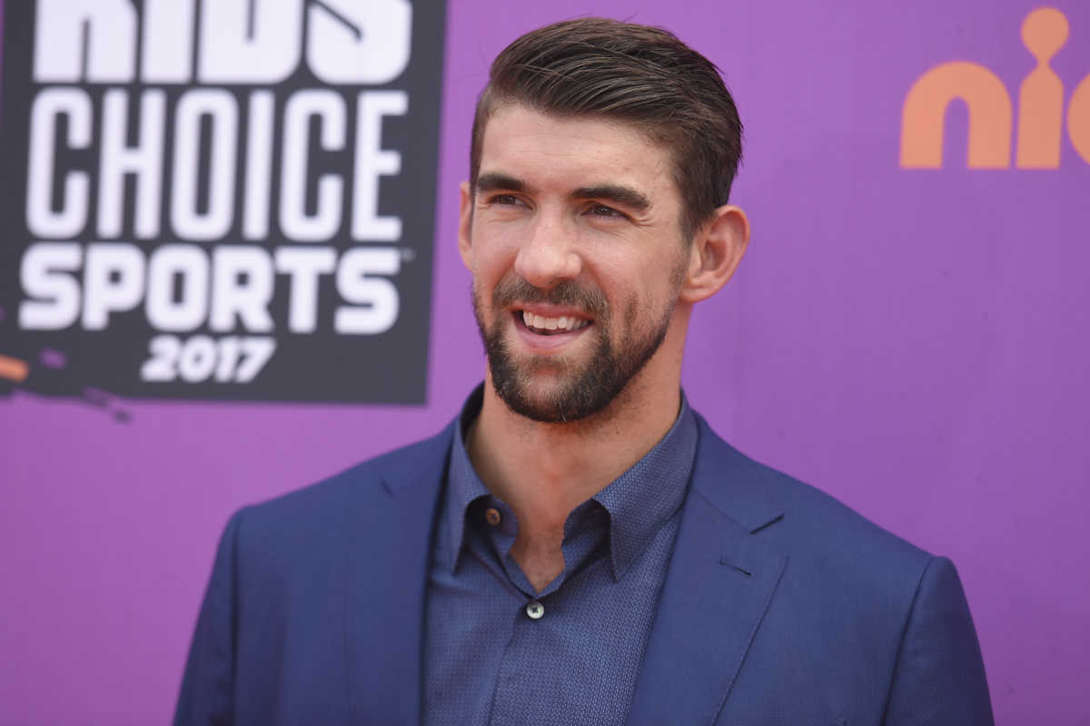 "In this July 13, 2017 file photo, retired Olympic swimmer Michael Phelps arrives at the Kids' Choice Sports Awards at UCLA's Pauley Pavilion in Los Angeles. Phelps lost to a shark in the Discovery Channel's Shark Week special ""Phelps vs. Shark: Great Gold vs. Great White,"" which aired on July 23, 2017. It was billed as a race between Phelps and the predator but much to the disappointment of some Twitter users, Phelps didn't actually swim in the water next to the shark"