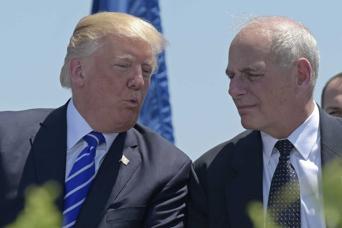 President Trump talks with John Kelly, then Homeland Security secretary, during commencement exercises at the U.S. Coast Guard Academy in New London, Conn. on May 17.<br />