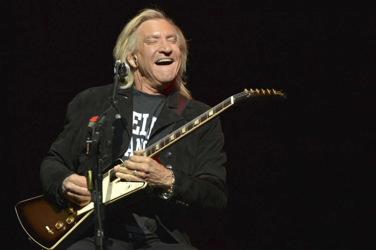 In this Jan. 15, 2014, file photo, Joe Walsh of The Eagles performs on the &amp;quot;History of the Eagles&amp;quot; tour at the Forum in Inglewood, Calif.<br />