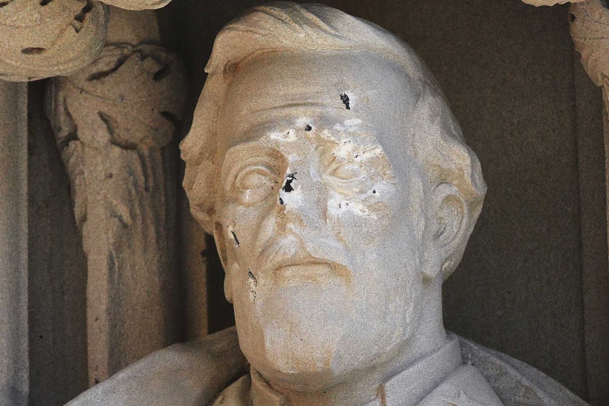 The defaced Gen. Robert E. Lee statue stands at the Duke Chapel on Thursday in Durham, N.C.