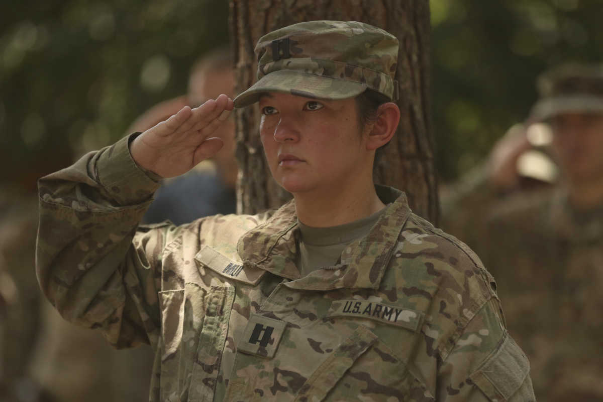 In this July 15, 2017 file photo, a U.S. soldier salutes during a change of command ceremony at Resolute Support headquarters in Kabul, Afghanistan.