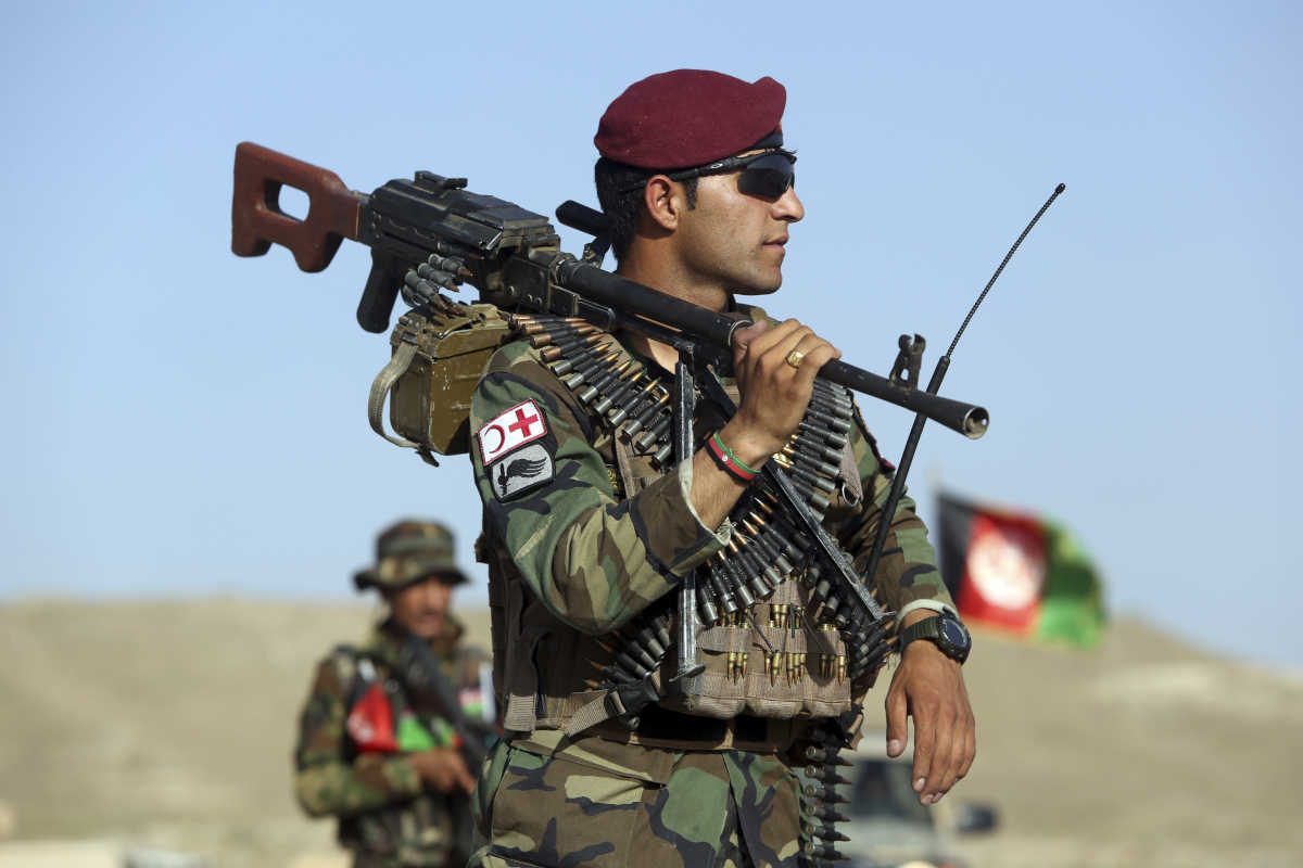 Afghan National Army soldiers stand guard at a checkpoint on the outskirts of Kabul, Afghanistan, on Monday.<br />