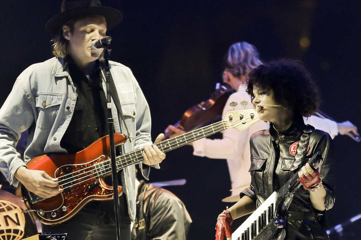 Arcade Fire&amp;#039;s Win Butler and Regine Chassagne perform at the Wells Fargo Center on Sunday.<br />