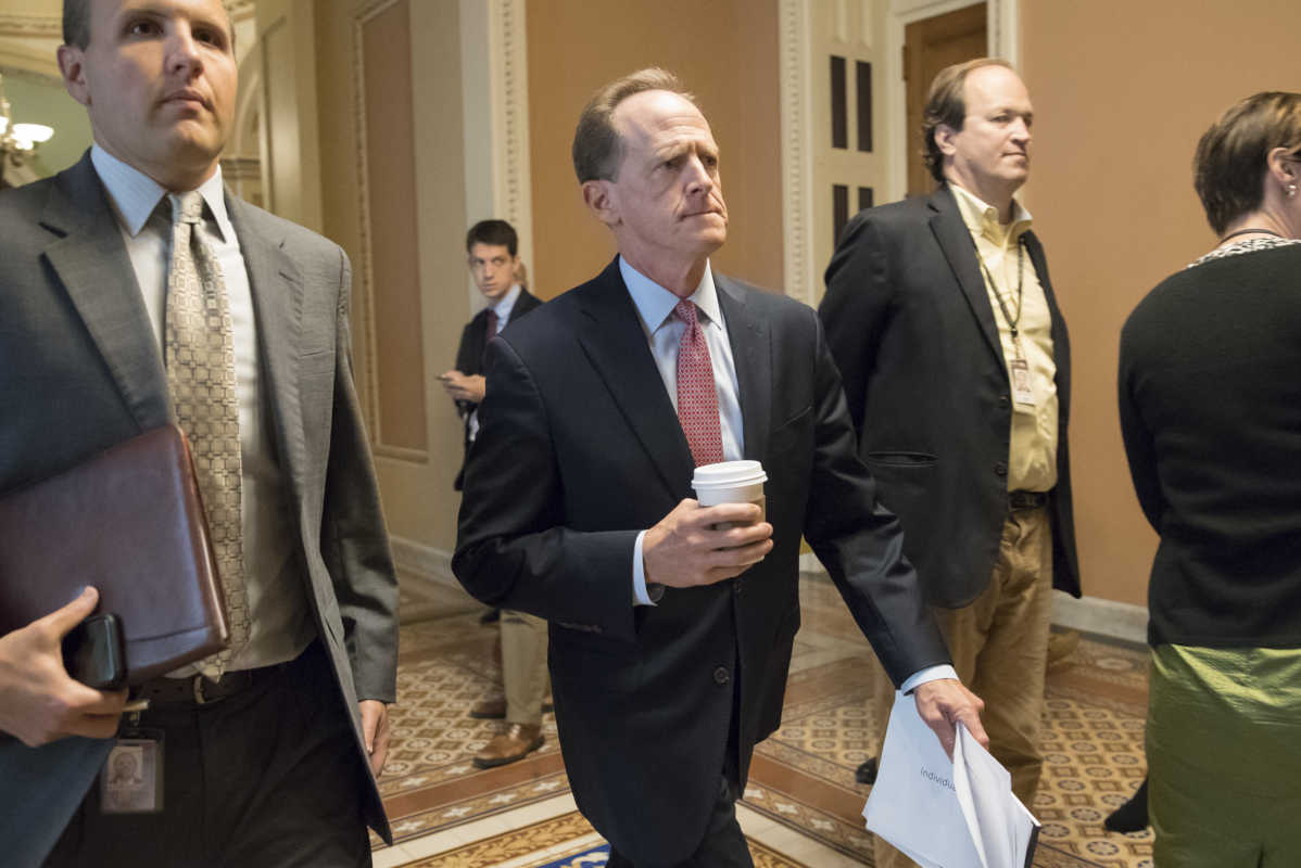 Sen. Pat Toomey (R., Pa.), a member of the Senate Budget Committee, strides to a closed-door meeting with Senate Majority Leader Mitch McConnell (R., Ky.); Treasury Secretary Steven Mnuchin; and Gary Cohn, President Trump&amp;#039;s top economic adviser, as they struggle with a tax code overhaul Tuesday.<br />