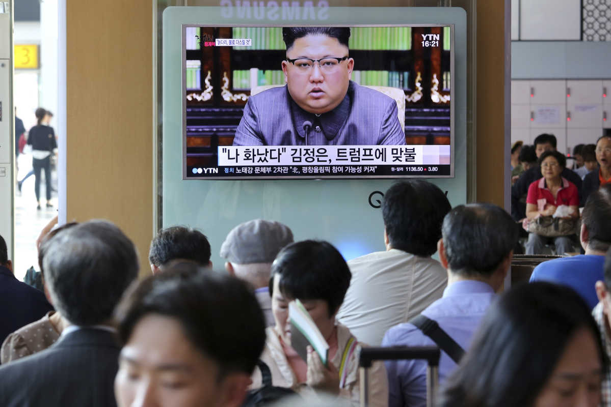 People watch a TV screen Friday in Seoul, South Korea, showing an image of North Korean leader Kim Jong Un delivering a statement in response to President Trump&amp;#039;s speech to the United Nations.<br />