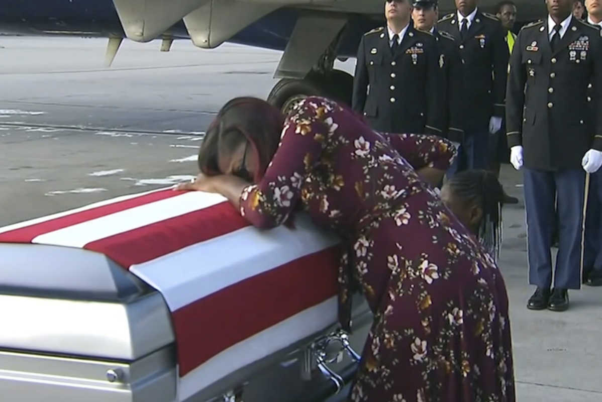 Myeshia Johnson cries over the casket in Miami of her husband, Sgt. La David Johnson, who was killed in an ambush in Niger.