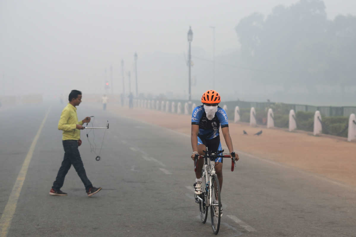 A cyclist pedals through the morning smog in New Delhi, India, on Friday.