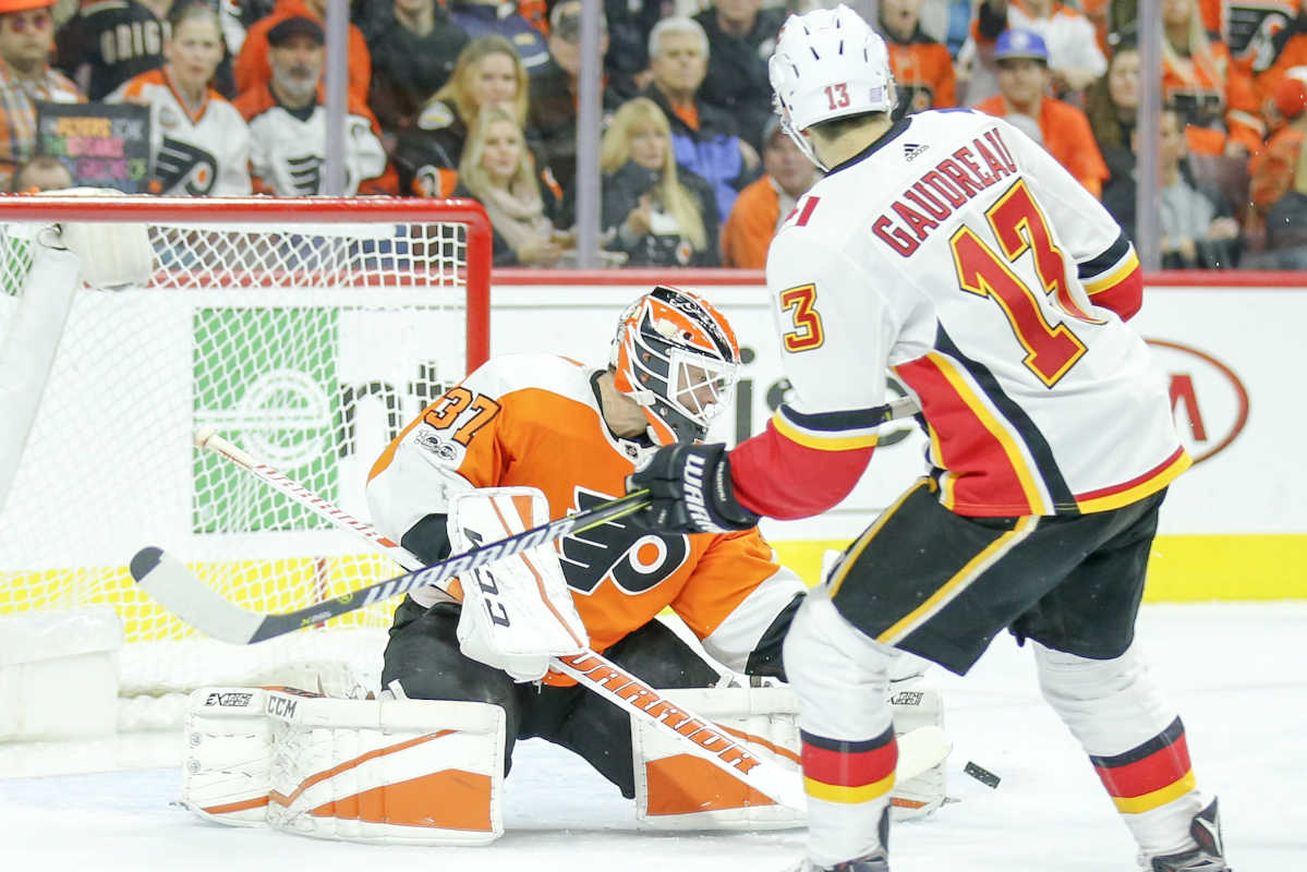 Flyers goalie Brian Elliott saves the puck during the second-period against Calgary Flames left wing Johnny Gaudreau on Saturday, November 18, 2017 in Philadelphia.