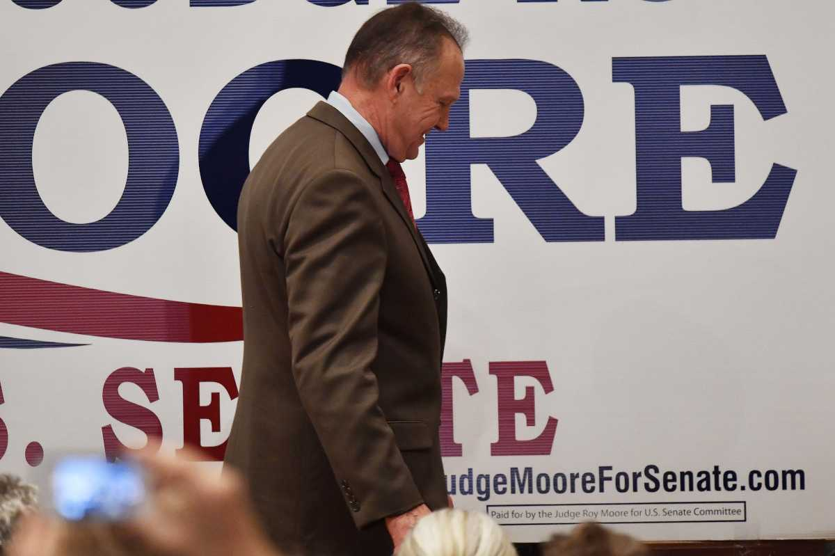 Senate candidate Roy Moore leaves the stage after speaking Tuesday in Montgomery, Ala.<br />