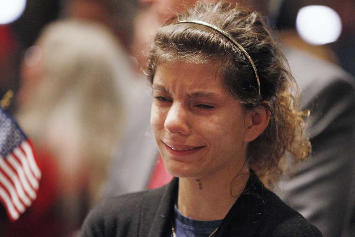 A Roy Moore supporter weeps during an election-night watch party in Montgomery, Ala.<br />