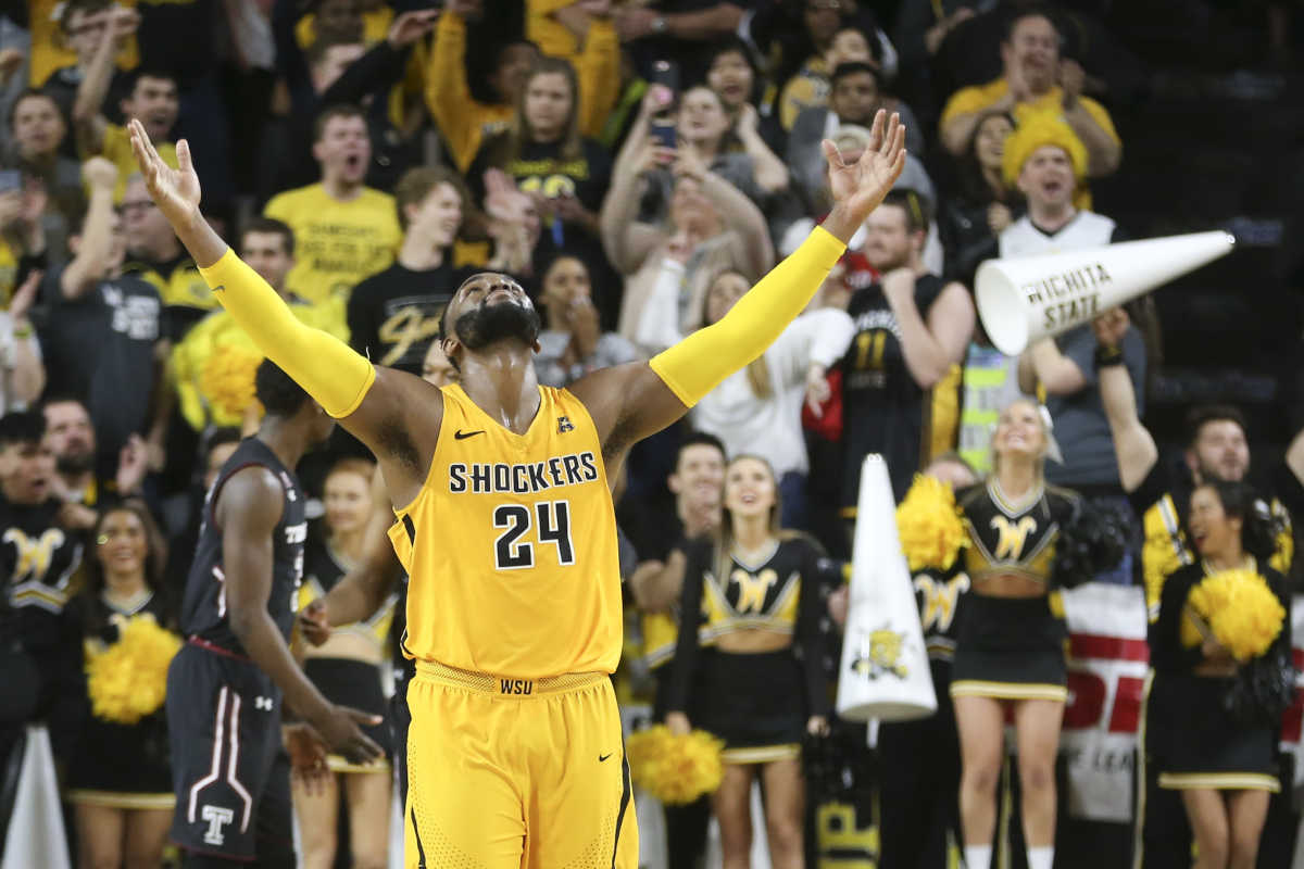 Wichita State center Shaquille Morris celebrates after the team defeated Temple 93-86 in an NCAA college basketball game Thursday, Feb. 15, 2018, in Wichita, Kan. (Travis Heying/The Wichita Eagle via AP)