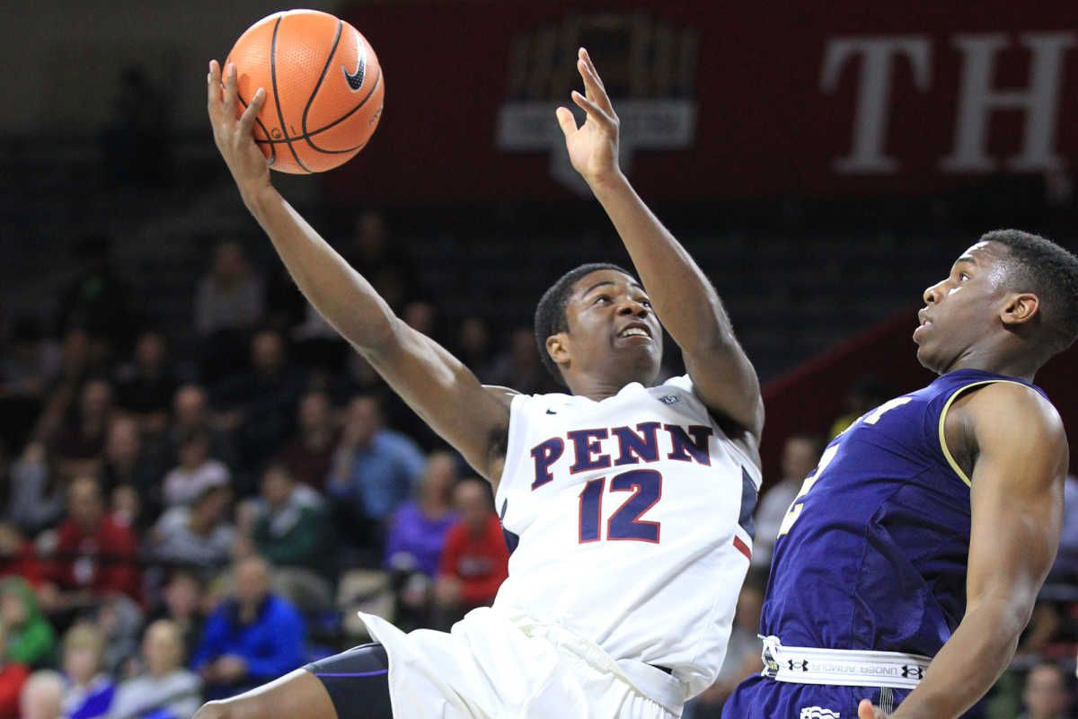 Devon Goodman, left, of Penn goes up for a shot against Hassan Abdullah of Navy during 1st half at the Palestra at the University of Pennsylvania on Nov. 15, 2017.