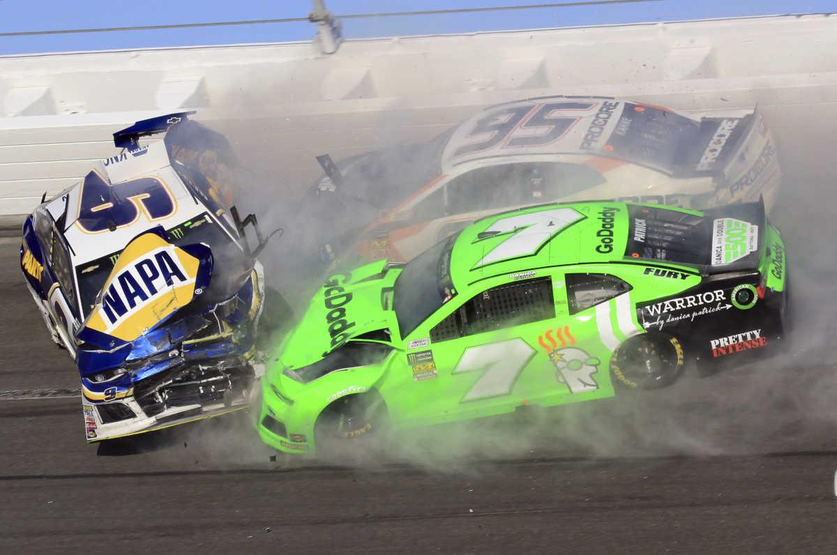 Chase Elliott (9), Kasey Kahne (95) and Danica Patrick (7) crash during the NASCAR Daytona 500 Cup series auto race at Daytona International Speedway in Daytona Beach, Fla., Sunday, Feb. 18, 2018. (AP Photo/Mike Troxell)
