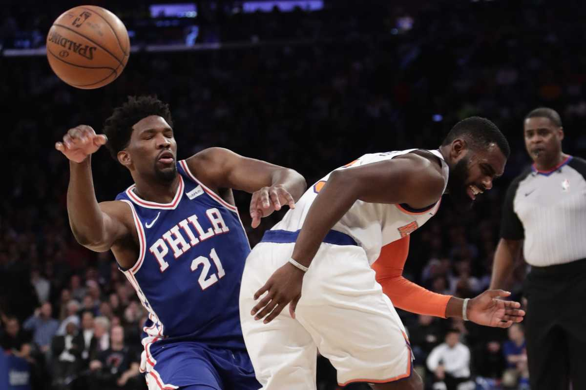 Philadelphia 76ers' Joel Embiid (21) passes away from New York Knicks' Tim Hardaway Jr. (3) during the first half of an NBA basketball game Thursday, March 15, 2018, in New York. (AP Photo/Frank Franklin II)