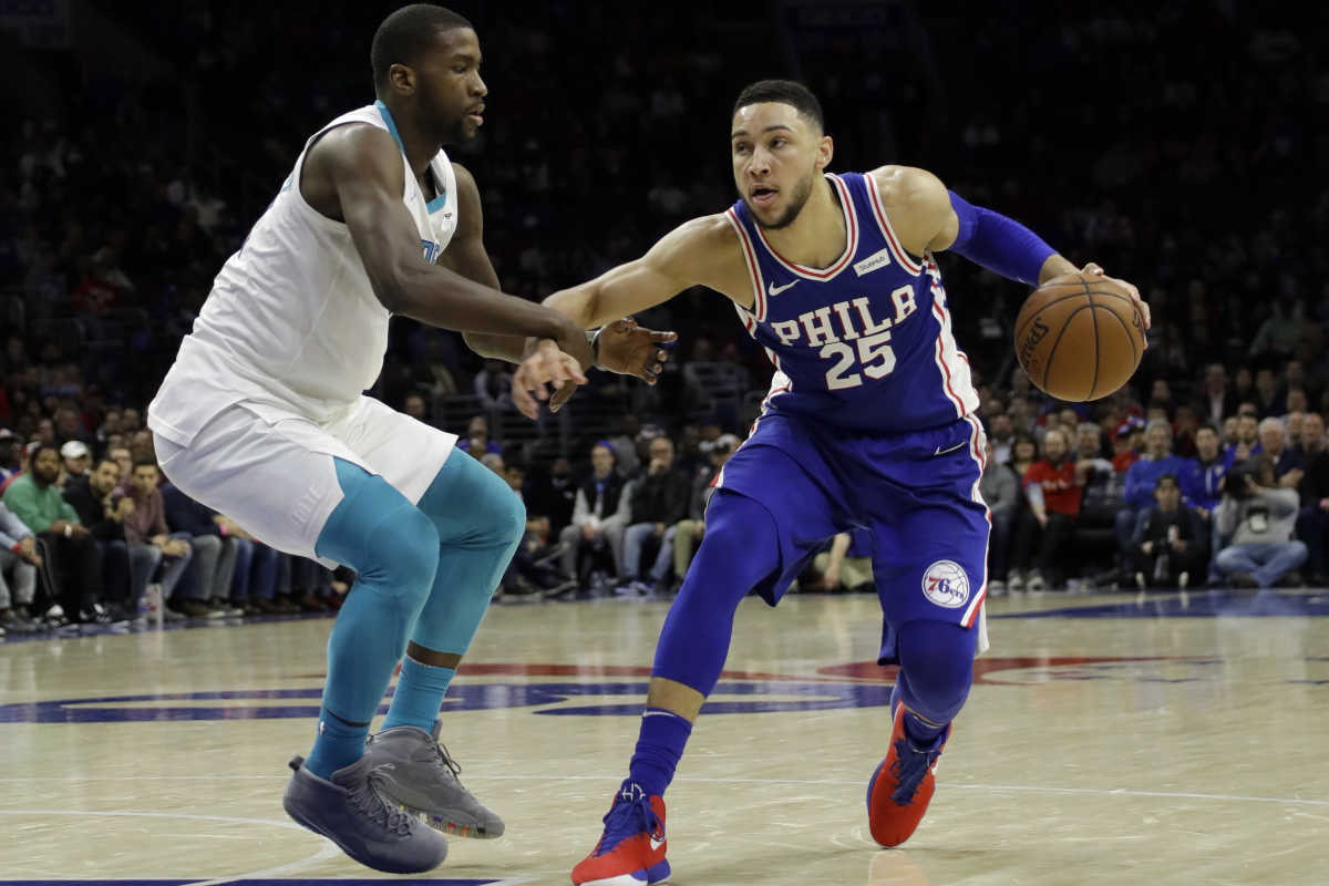 Philadelphia 76ers' Ben Simmons, right, dribbles past Charlotte Hornets' Michael Kidd-Gilchrist during the second half of an NBA basketball game, Monday, March 19, 2018, in Philadelphia. (AP Photo/Matt Slocum)