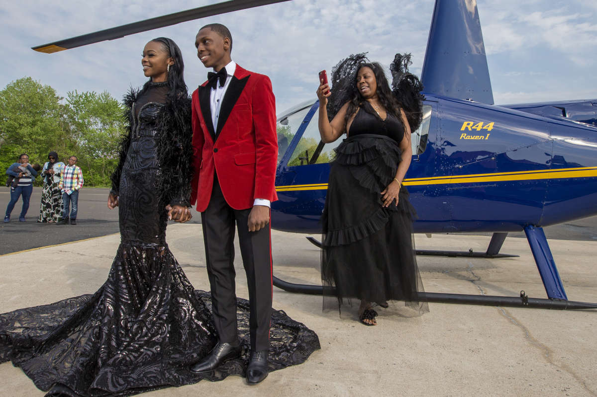 Saudia Shuler, right, films her son, Nieme Brooker with his date Tiana Johnson in this James Bond-style prom send-off on May 12, 2018. They attended the Penn Wood prom later that evening.