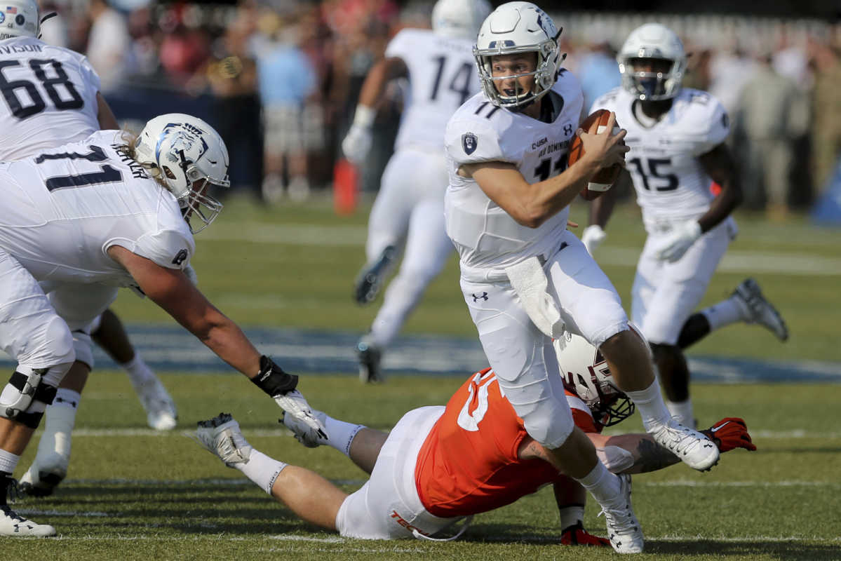 Old Dominion quarterback Blake LaRussa avoids a sack by Virginia Tech's Jerrod Hewitt during the first half of an NCAA college football game Saturday, Sept. 22, 2018, in Norfolk, Va. (AP Photo/Jason Hirschfeld)
