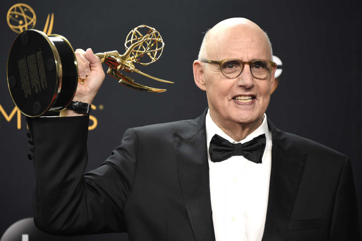 """Jeffrey Tambor poses in the press room with the 2016 award for lead actor in a comedy series for """"Transparent."""" It was his second straight Emmy."""