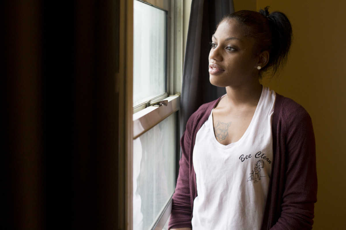 Brandi Cooper, 25, stands in her home in Bartram's Village in West Philadelphia. Cooper takes PrEP as a precautionary measure to prevent HIV Wednesday, November 30, 2016. PreP has been unpopular among many people, and Cooper believes there is a stigma around it. ( MARGO REED / Staff Photographer)
