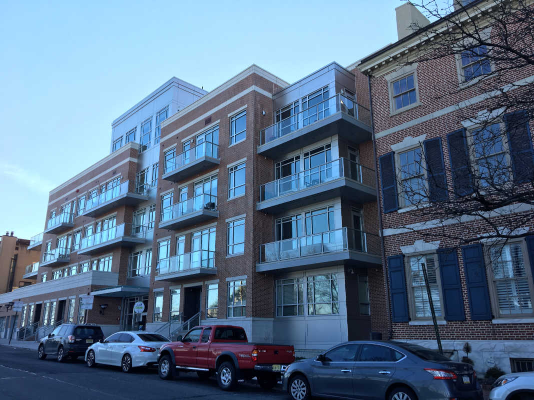 While not good design, Toll Bros.' recently completed apartment building on the former NewMarket Site shows how a mid-rise building can be absorbed into the Society Hill neighborhood.