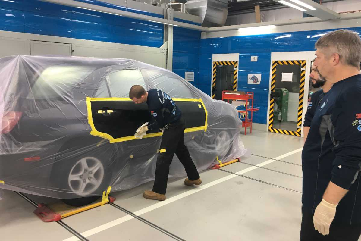Ready for its 3D closeup: an SUV rolls down the line (note the track system under the wheels) in preparation for the first of two infrared heat treatments.