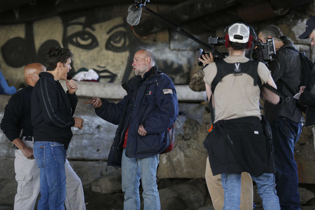 Television personality Dr. Oz, left, interviews Steve Johnson, 49, formerly of Washington Township, NJ, talks about his heroin use during a tour of a heroin encampment near 2nd and Indiana in Philadelphia on April 10, 2017.
