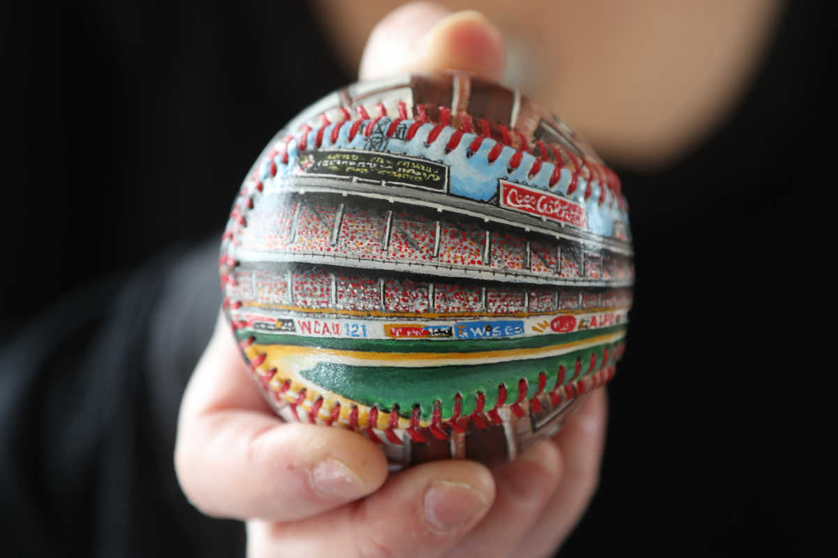 An Emily Wolfson Unforgettaball of Connie Mack Stadium is a finely-detailed reproduction of her painting on a collectible baseball. The Bala Cynwyd artist has designed 150 Unforgettaballs in 22 years.