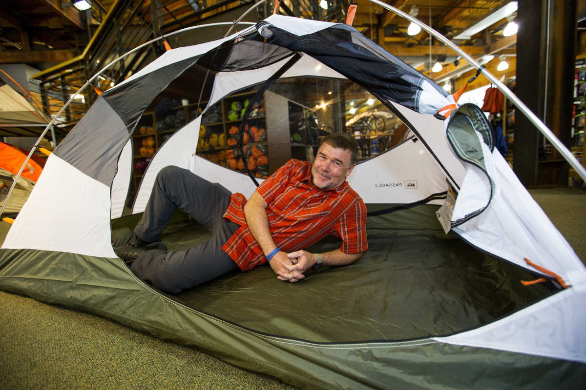 REI´s chief executive, Jerry Stritzke, stretches out in a tent at the flagship store in Seattle. (Mike Siegel/Seattle Times/TNS)