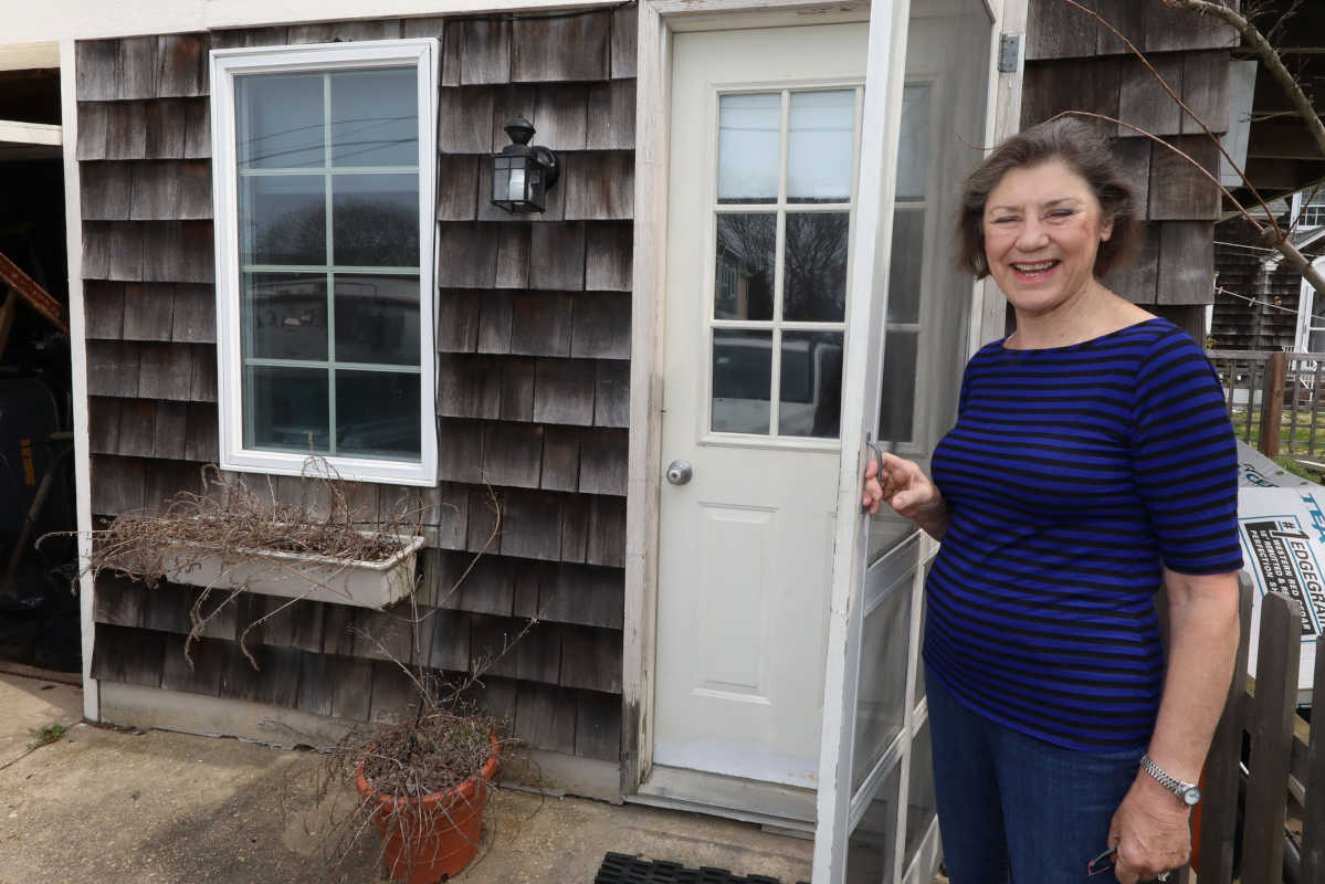 Year-long resident Diane Carter of Beach Haven, preps the detached apartment she hopes to be renting out during the summer season at her property in the southend of LBI, NJ.