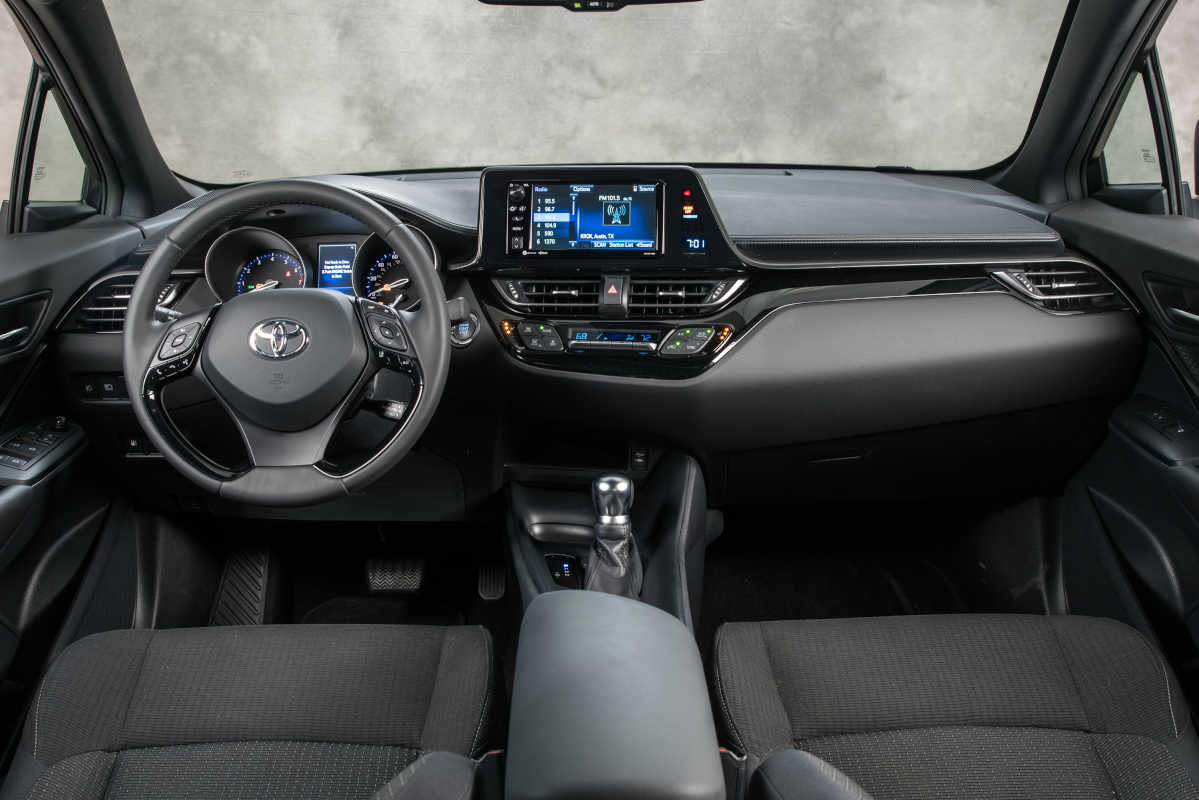 Inside the 2018 Toyota C-HR, creature comforts are kept to a minimum, but simple controls and comfortable seats may keep your mind off your troubles.