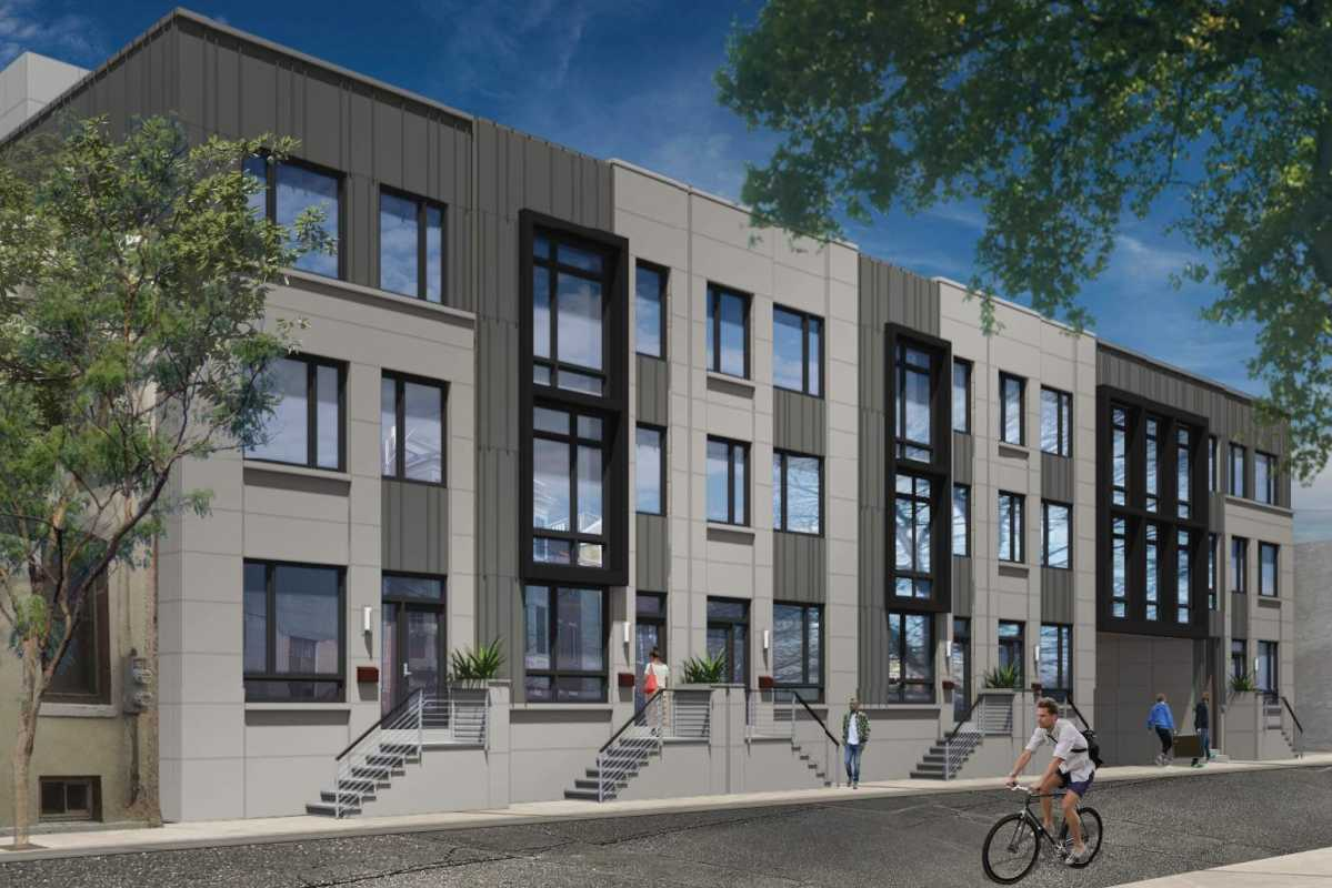 Artist's rendering of townhouses on Kater Street that are part of the planned Royal residential complex, which is to incorporate the facade of the historic Royal Theater on its South Street-facing side.
