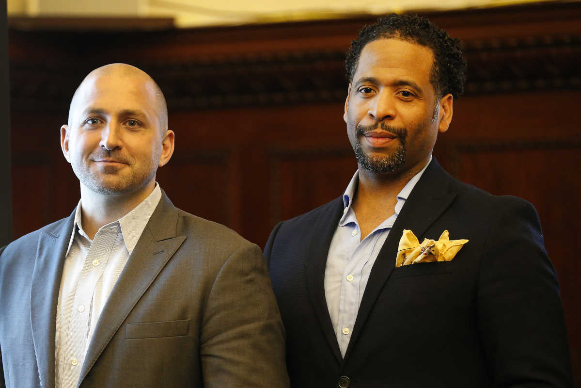 Benjamin's Desk co-founder and co-CEO Anthony Maher (left) and Shelton Mercer, who will direct the Challenge Center initiative, at Tuesday afternoon's news conference at City Hall to announce the alliance between Benjamin's Desk and Washington-based 1776.
