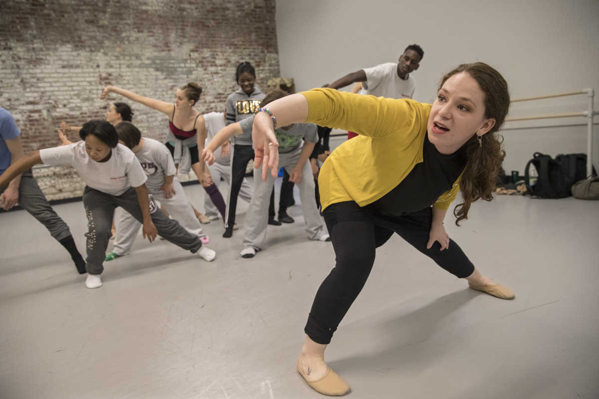 Choreographer Jennifer Kilpatrick rehearses a move with her combined cast of Pennsylvania Ballet II dancers and students with disabilities from St. Katherine Day School in Wynnewood.  They will perform their joyful dance on Saturday at FringeArts.