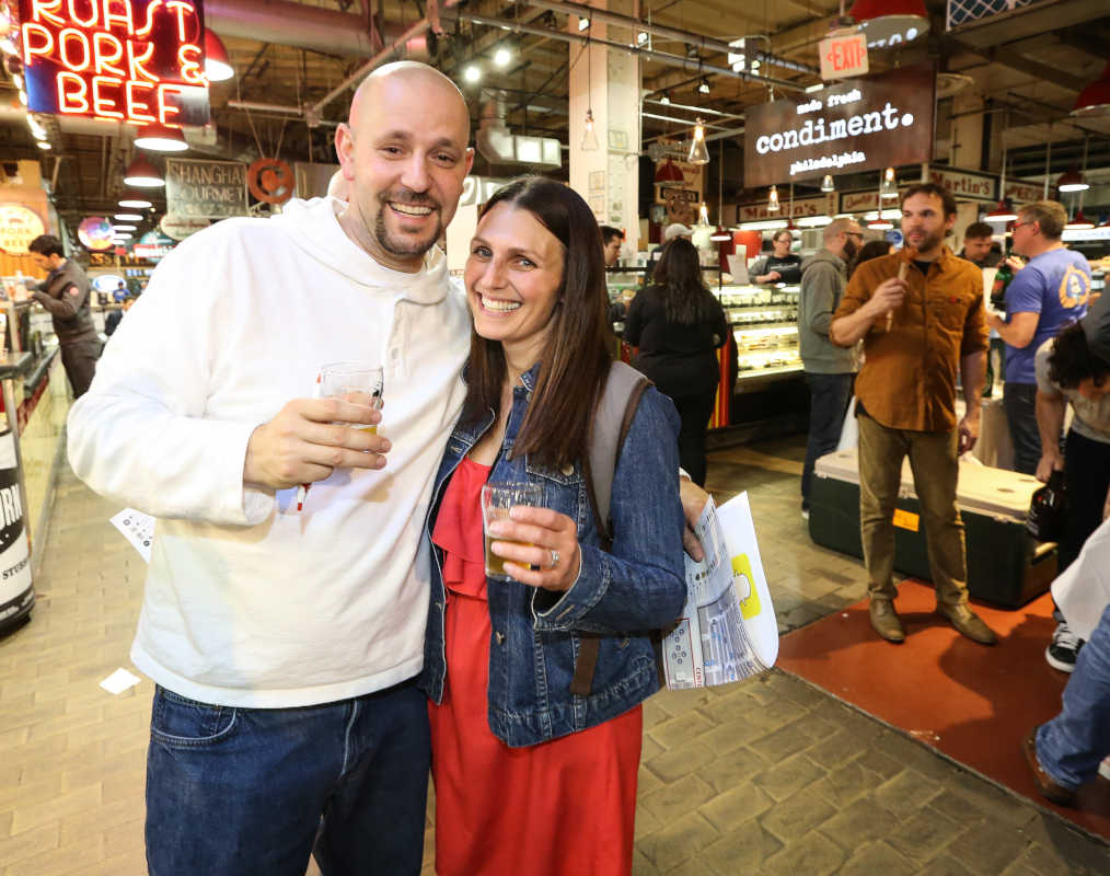 Jerrett and Amanda Muzi from Ardmore enjoying Brewvitational at the Reading Terminal Market, Thursday, May 11, 2017.