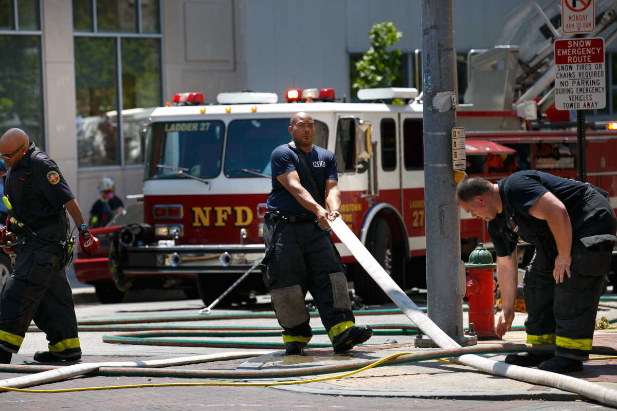 Firefighters at the scene of a fire at 2 West Main Street, in Norristown, on May 18, 2017. ( STAFF PHOTOGRAPHER / Jessica Griffin ).
