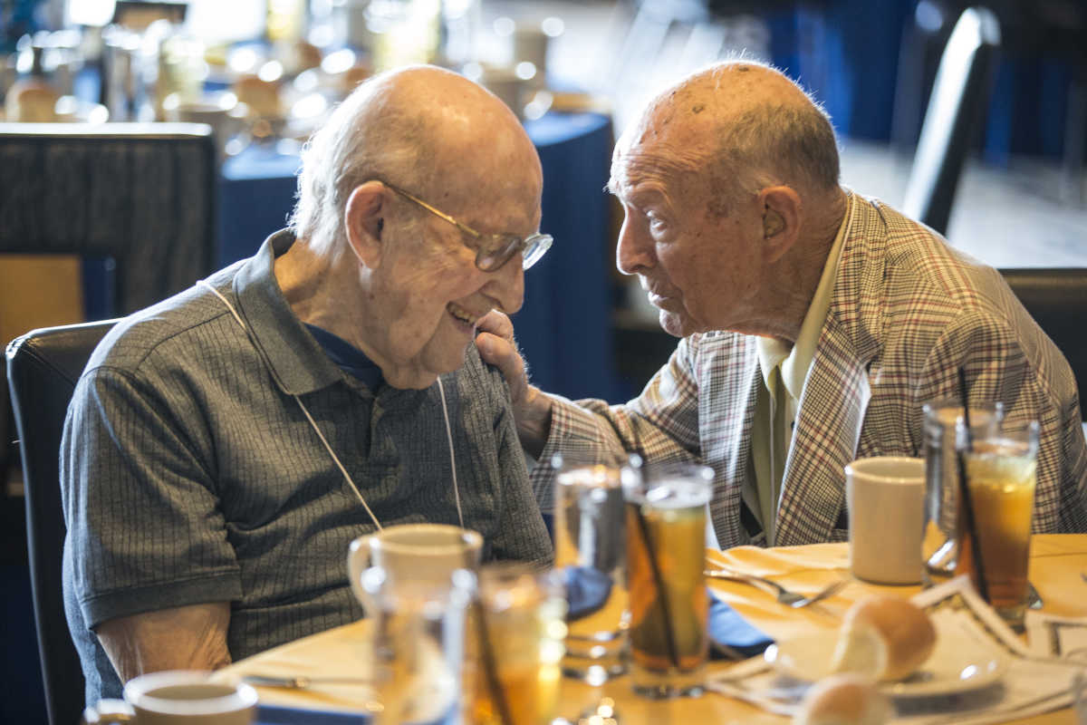 Sylvan Brandman (left), 101, with Vincent Verruno, 99, before the luncheon began.<br />