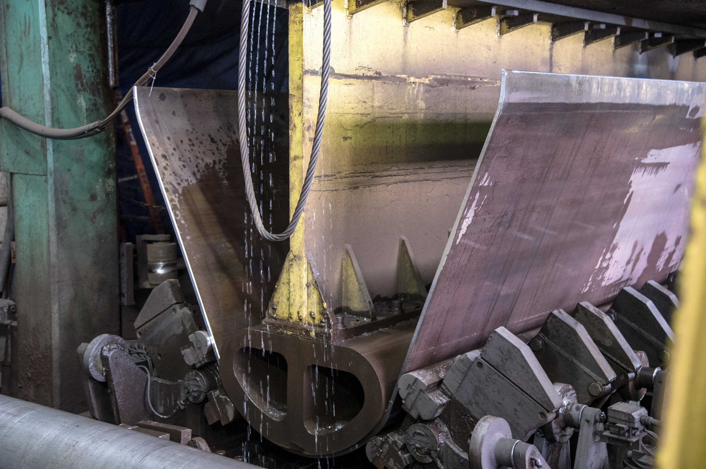A 20,000 ton U-press at the Dura-Bond Industries steel pipe fabricating factory in Steelton, Pa,. begins the process of shaping a 6-ton steel plate into a circular 42-inch pipe.  The company, started in 1960, supplies coated steel pipes to oil and gas industry underground pipelines.