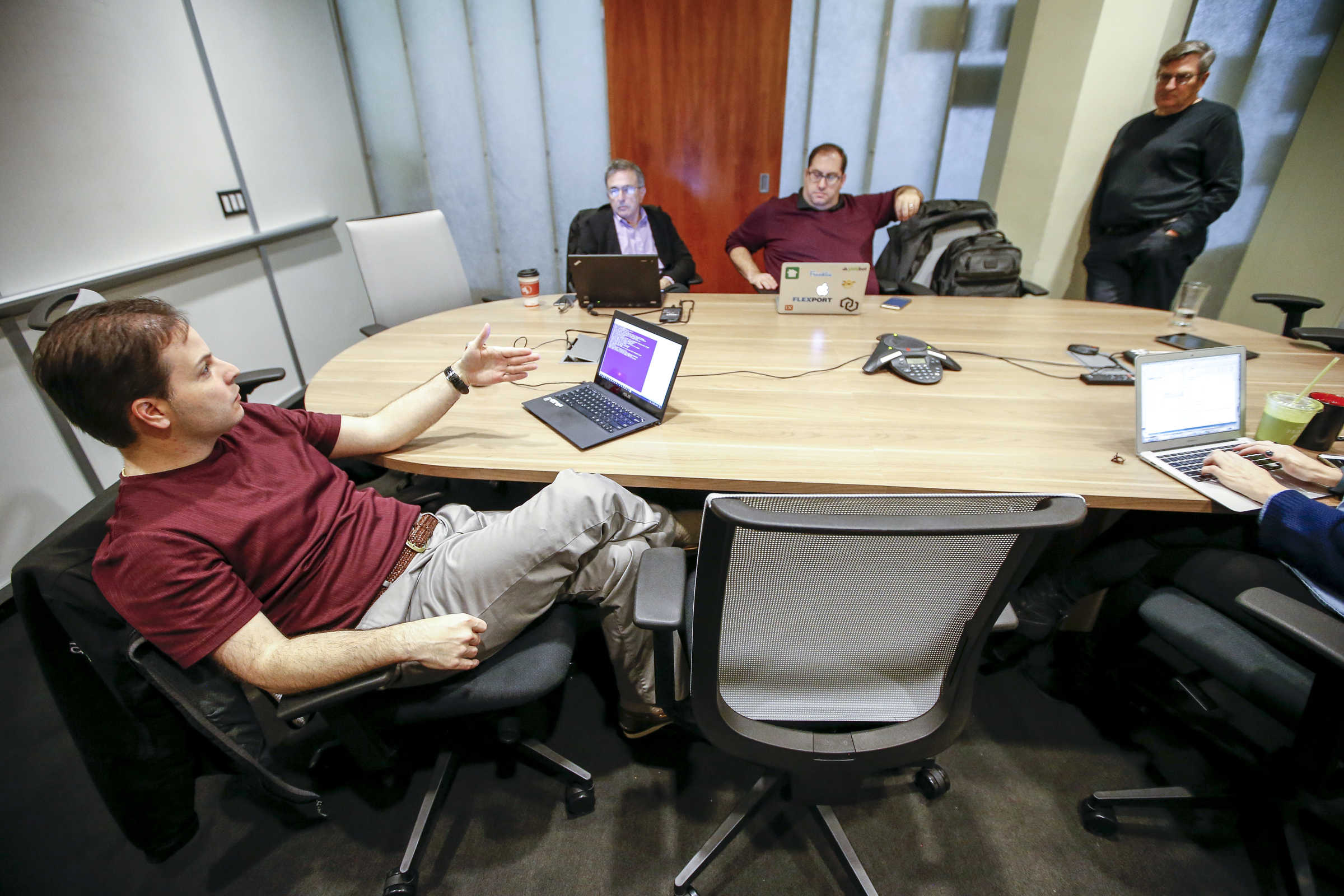 Paul Martino, left, general partner at Bullpen Capital, meets with general partners Richard Melmon, Eric Wiesen, and Duncan Davidson, right, during a board meeting.
