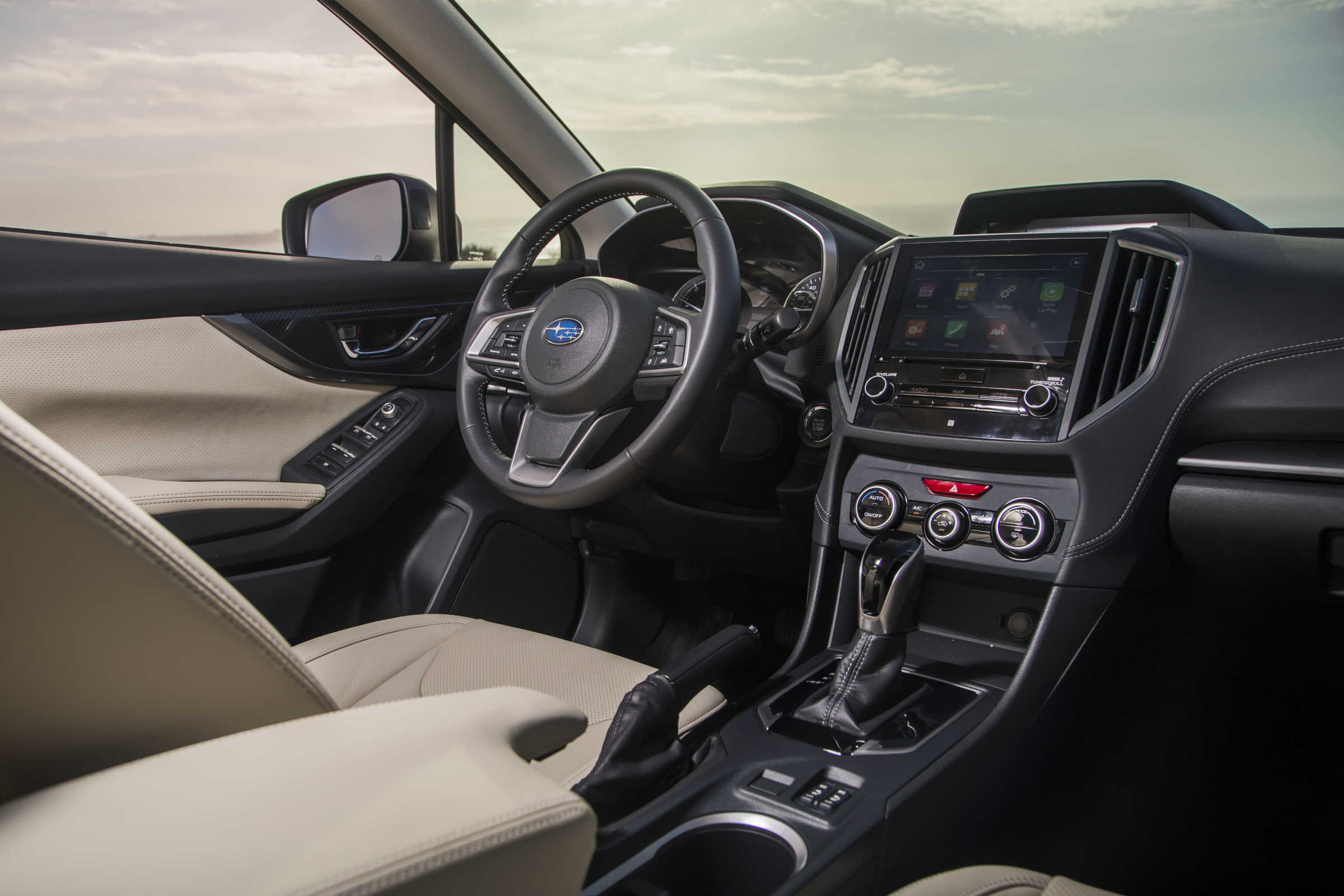 The 2017 Subaru Impreza offers a fairly comfy cabin for driver and passenger, though the new infotainment system could be stubborn.