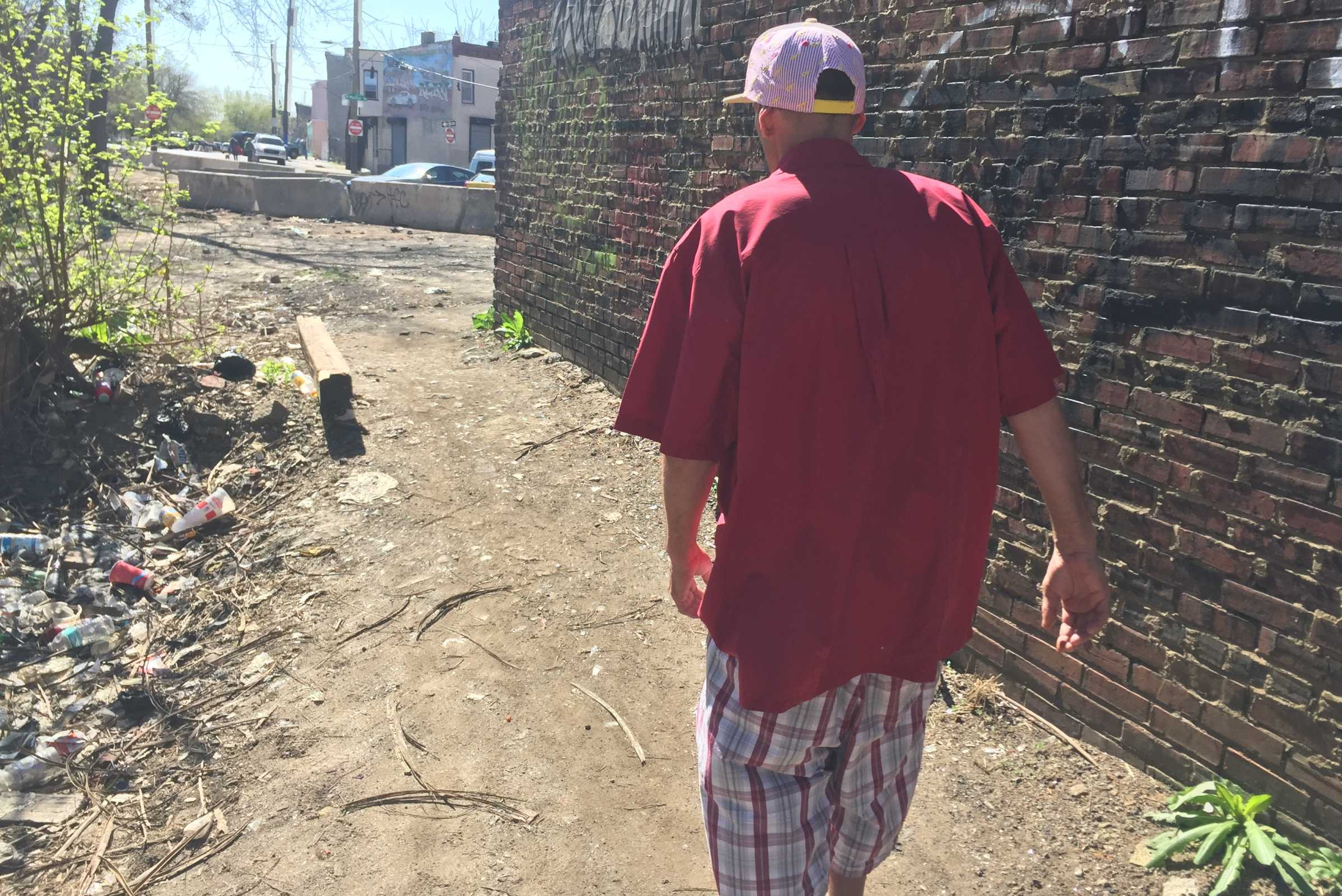 A man named Mike leaves the heroin encampment in Philly's Fairhill section on Tuesday. He comes daily, his says, to get high. He did not plan on watching the Dr. Oz show.