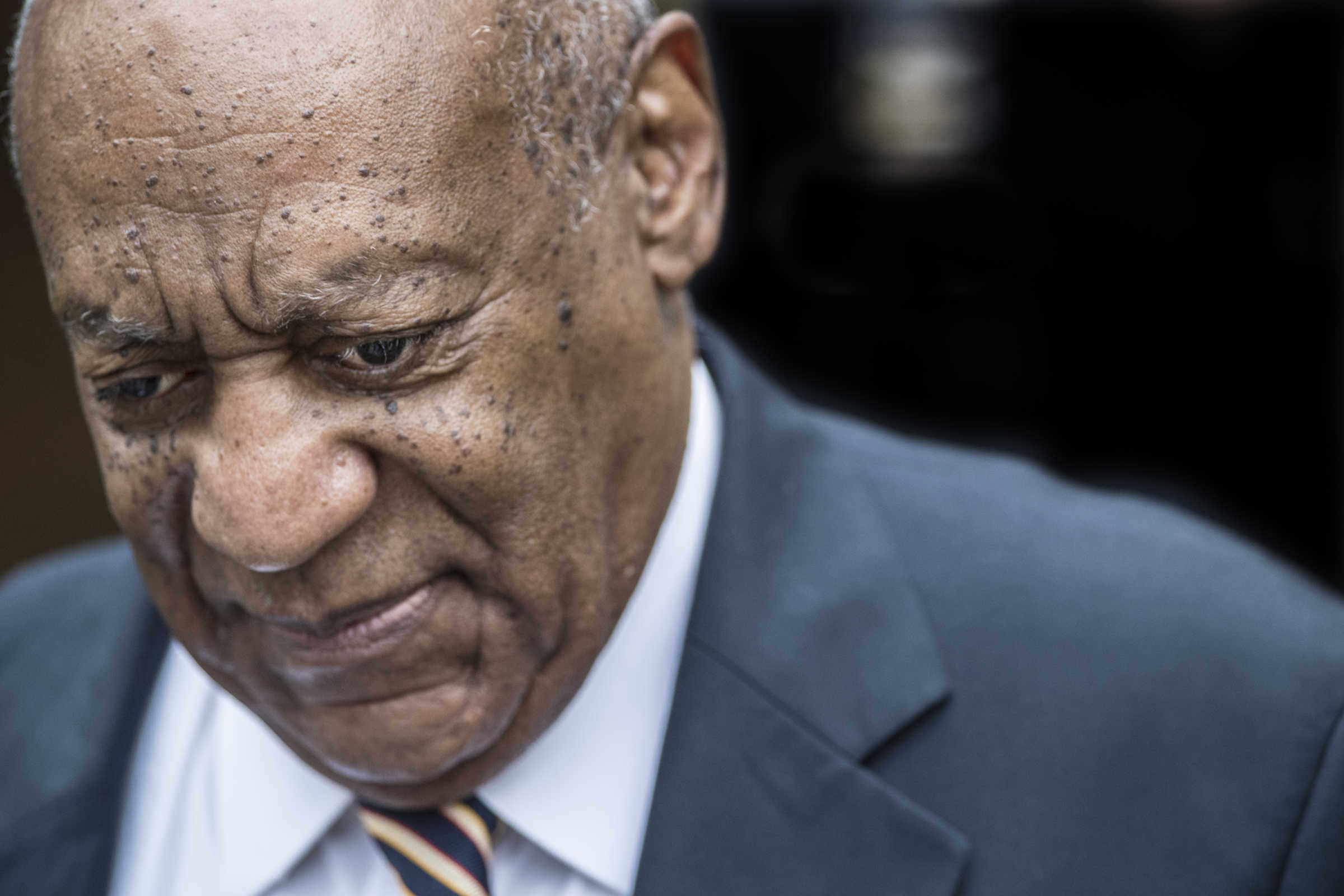 Bill Cosby walks up the sidewalk to the Montgomery County Courthouse on Wednesday June 14, 2017, the third day of jury deliberation in his sexual assault trial.