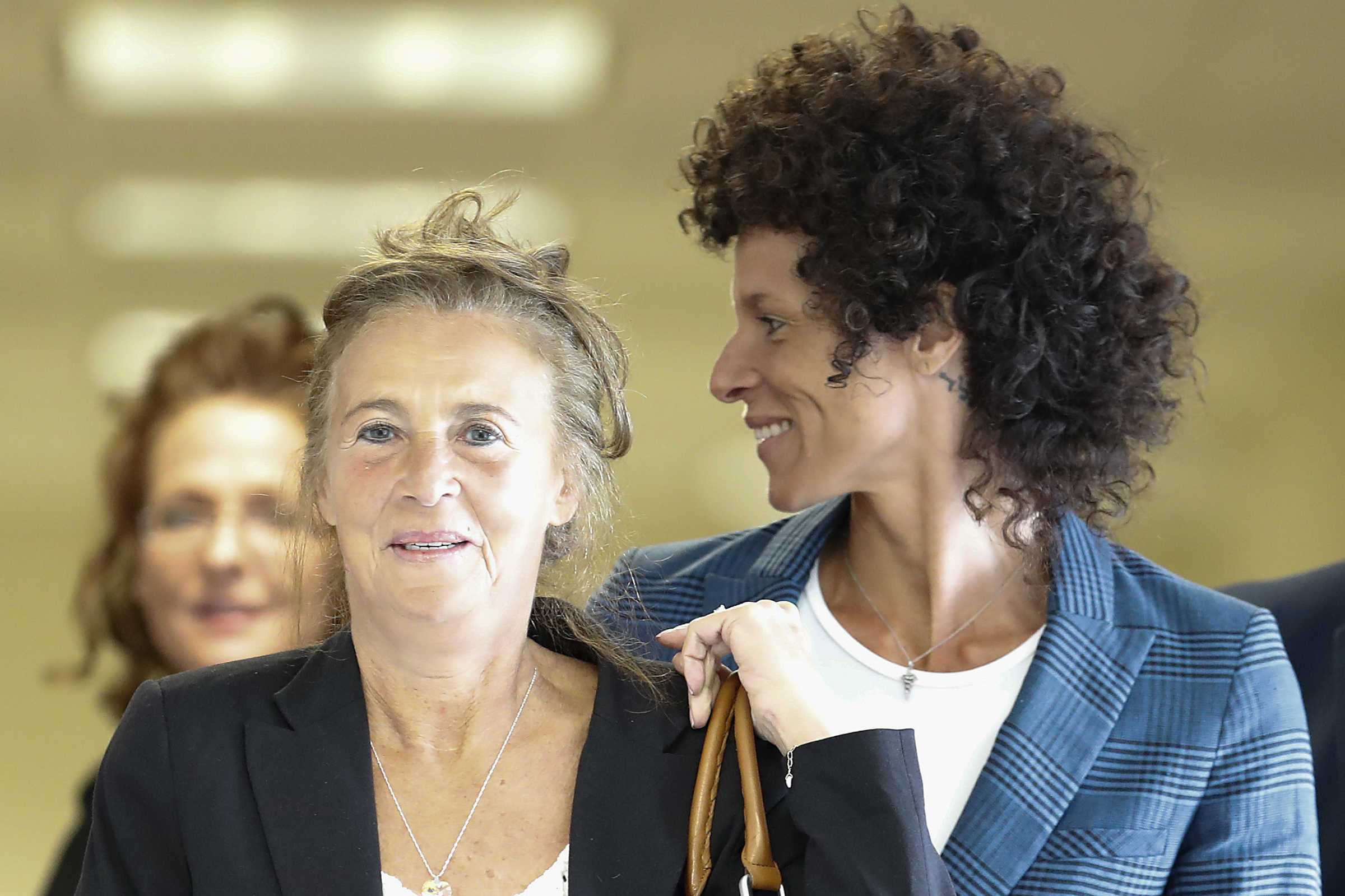 Gianna Constand, left, and her daughter Andrea Constand, right, walk toward the courtroom inside the Montgomery County Courthouse in Norristown, PA on June 12, 2017. Cosby is on trial for sexual assault. Both women testified in the trial.