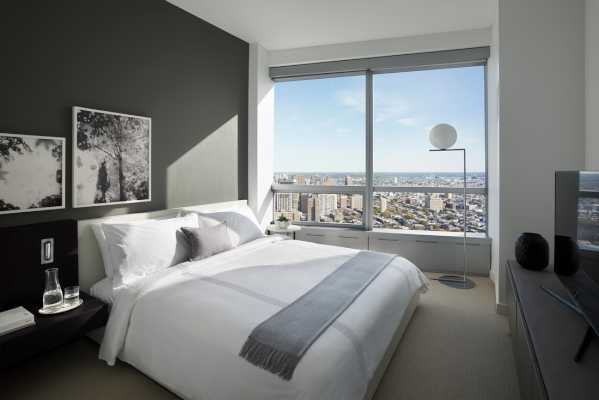A rendering of a furnished bedroom at AKA University City.