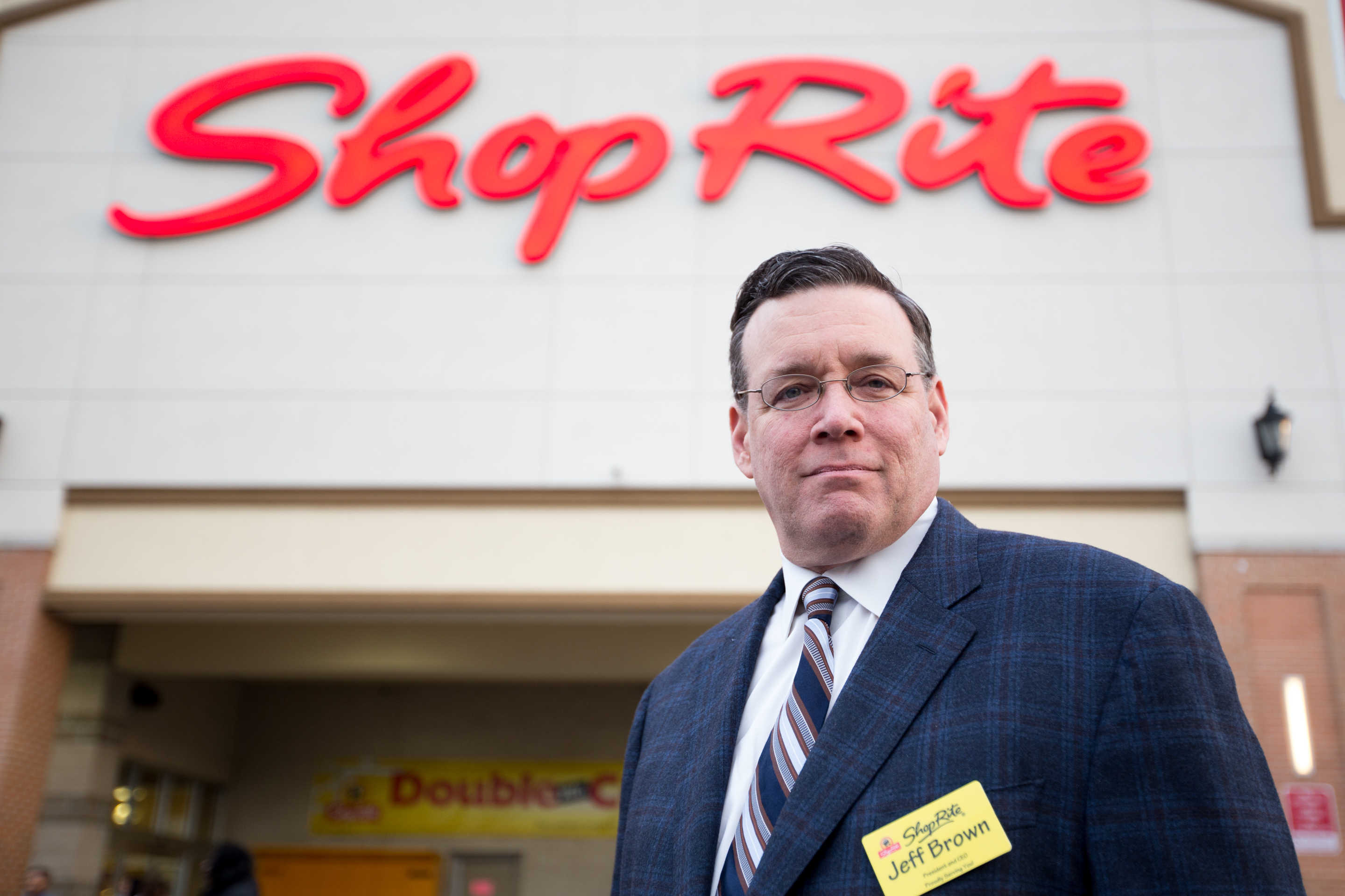 Jeffrey Brown, chief executive of Brown's Super Stores Inc., a chain of 13 ShopRite and Fresh Grocer supermarkets, stands in front of his store on Fox Street in Philadelphia. Brown has made it his mission to hire the formerly incarcerated.For the Inquirer: Margo Reed