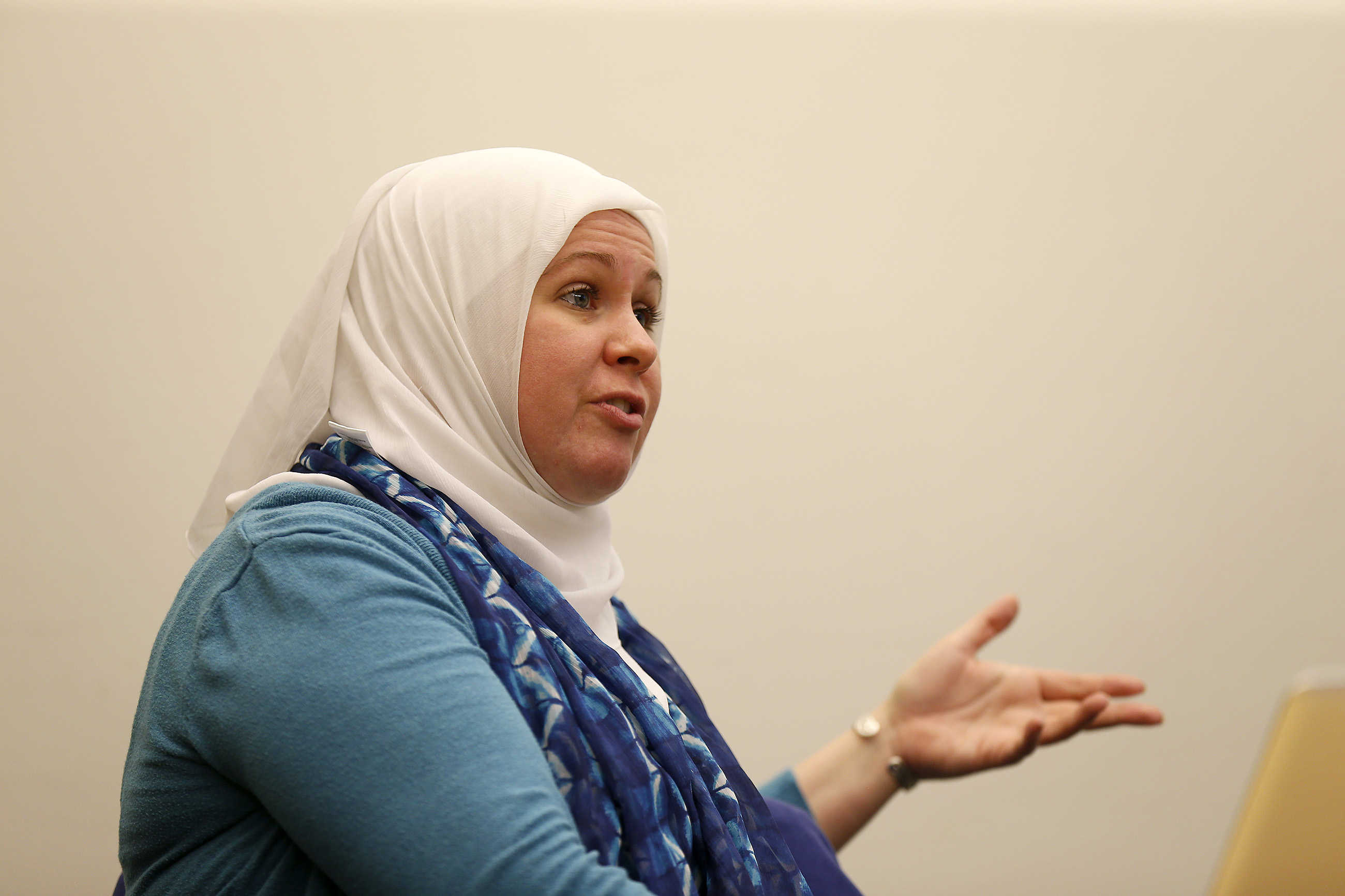 Patty Anton, a chaplain with the Muslim Students Association, talks with Emile Bruneau about videos that might reduce negative views of Muslims.