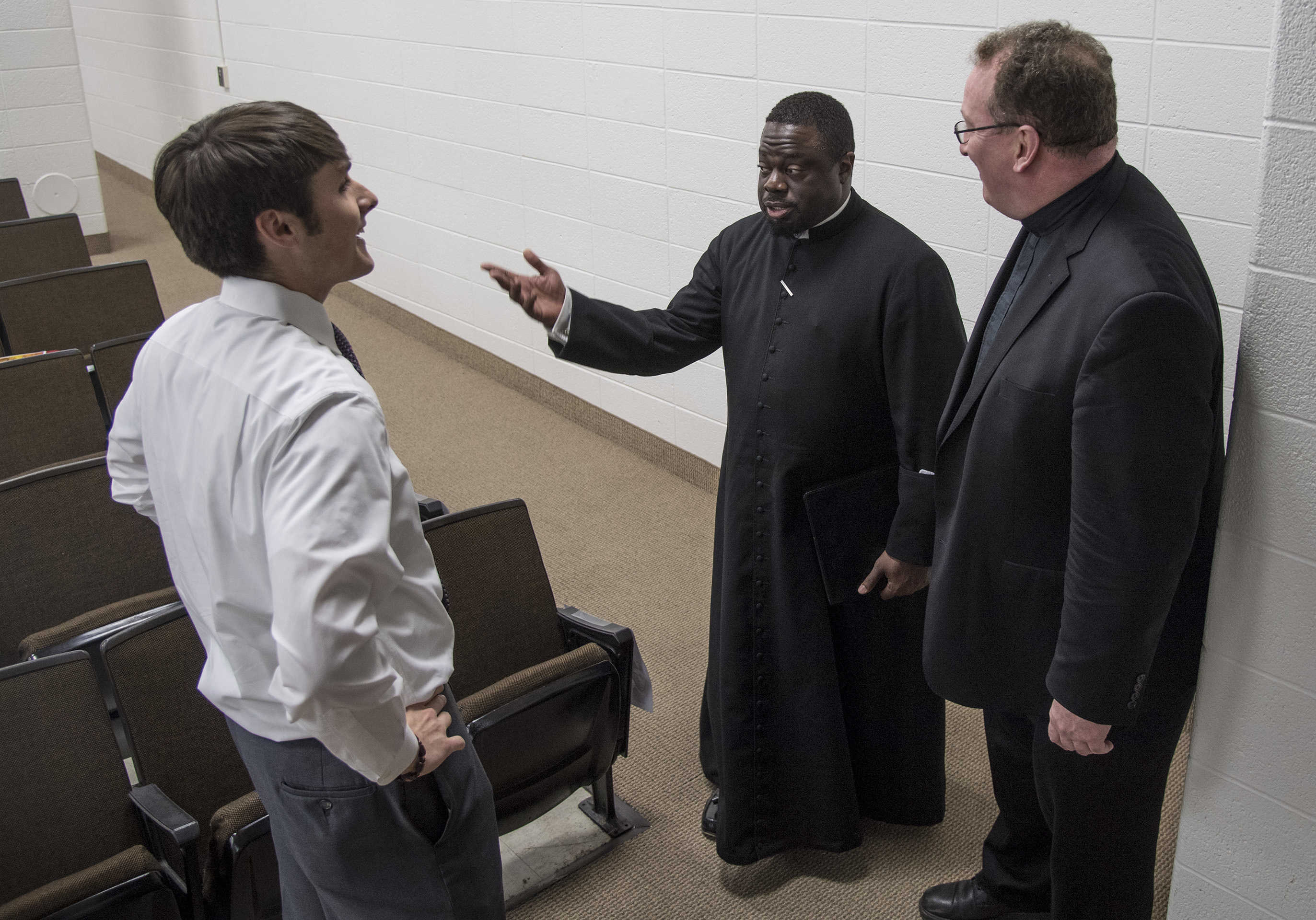 St. Charles Borromeo seminarian James Moses (center), from Brooklyn, speaks with Father Stephen DeLacy (cq, right), vocation director for the Archdiocese, and Bill Rose, producer and director of the short documentary film Tolton, prior to an event at the seminary April 2, 2017 designed to recruit African American Catholics into the priesthood.  The short film Rose debuted was on the life and struggles of the first black Catholic priest, Augustus Tolton.  CLEM MURRAY / Staff Photographer
