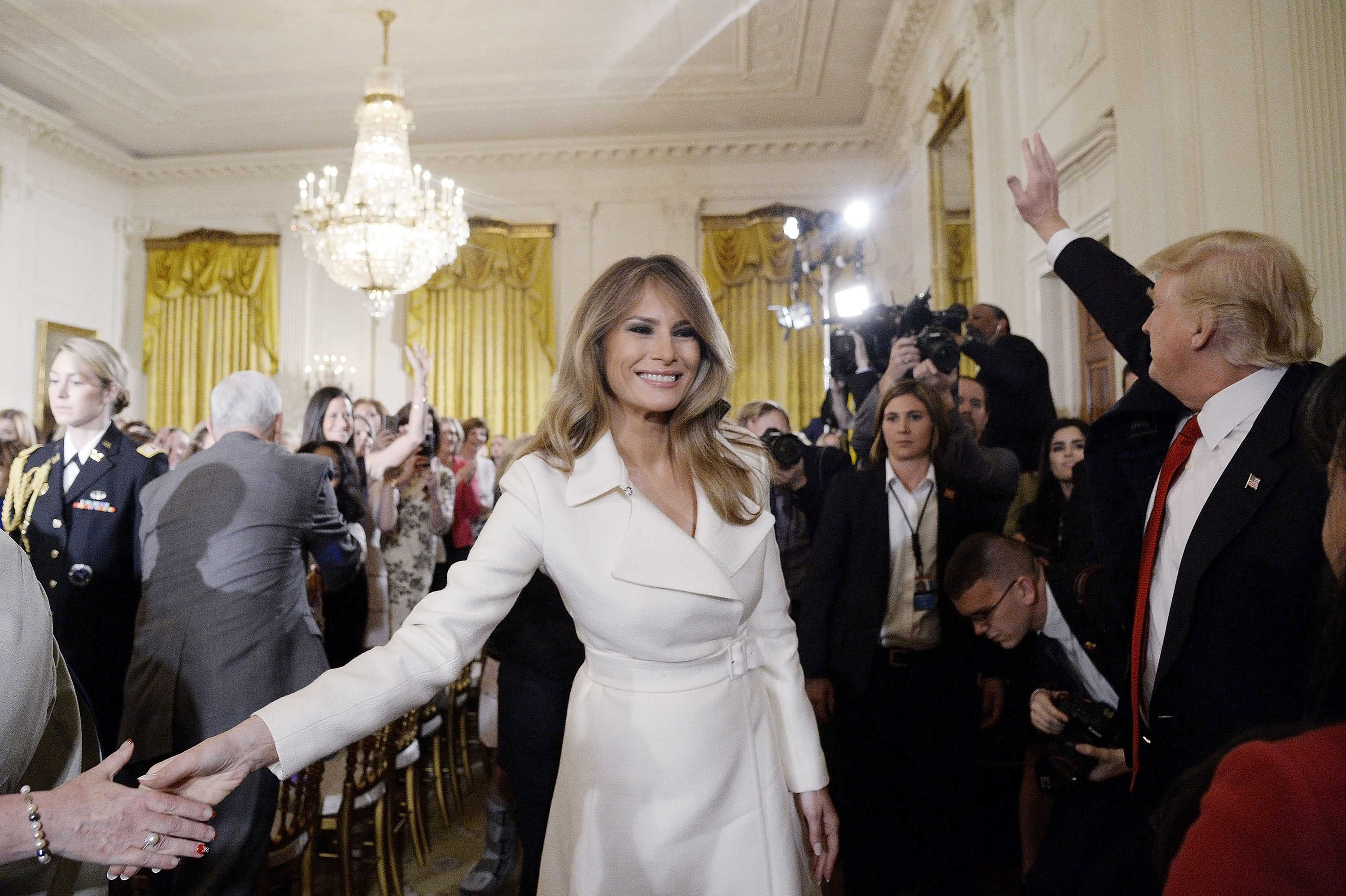 First lady Melania Trump attends the Women´s Empowerment Panel on Wednesday, March 29, 2017 in an optic white tailored coat dress