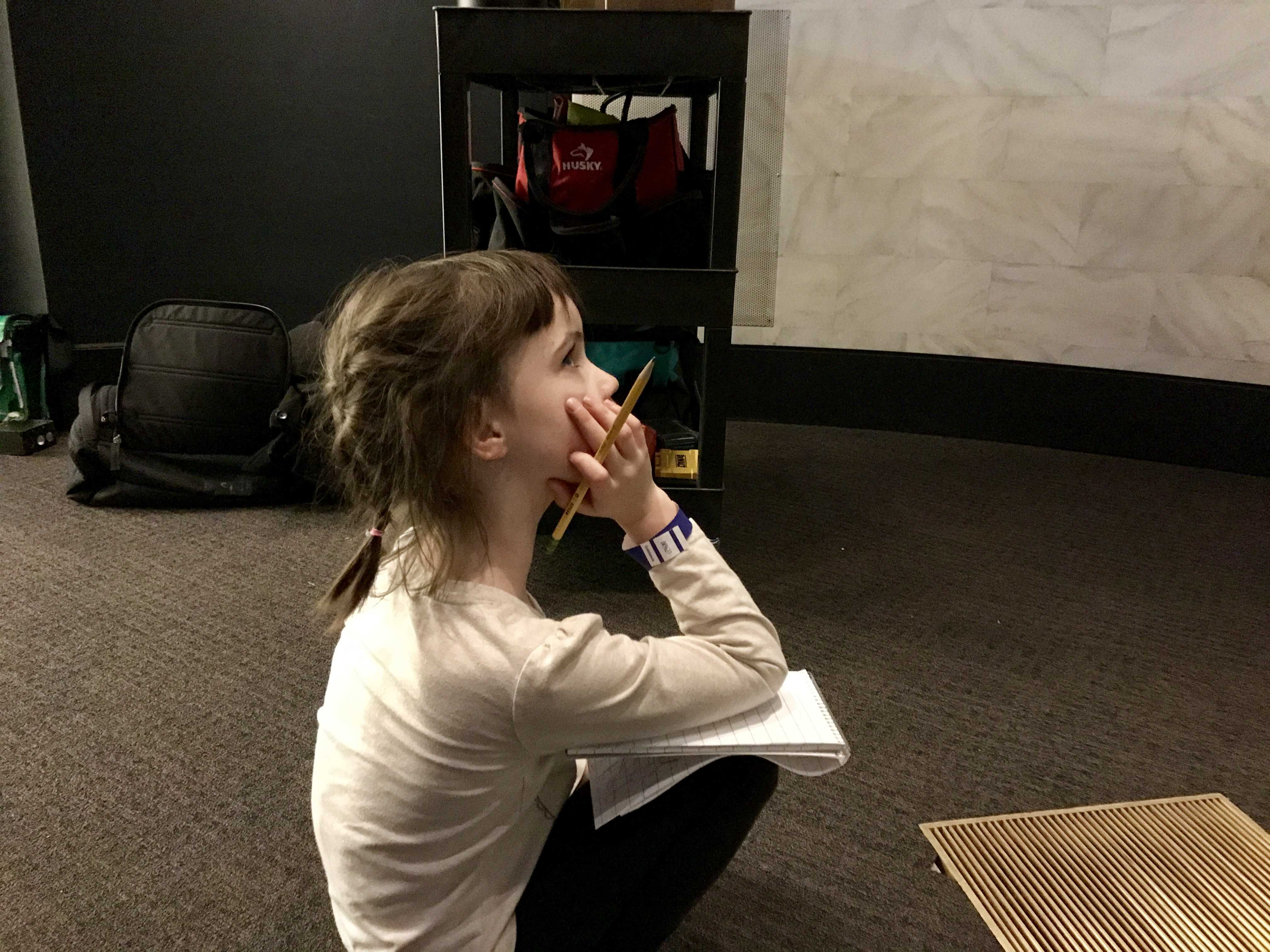 Addie Smith watches a short film about the start of the American Revolution.