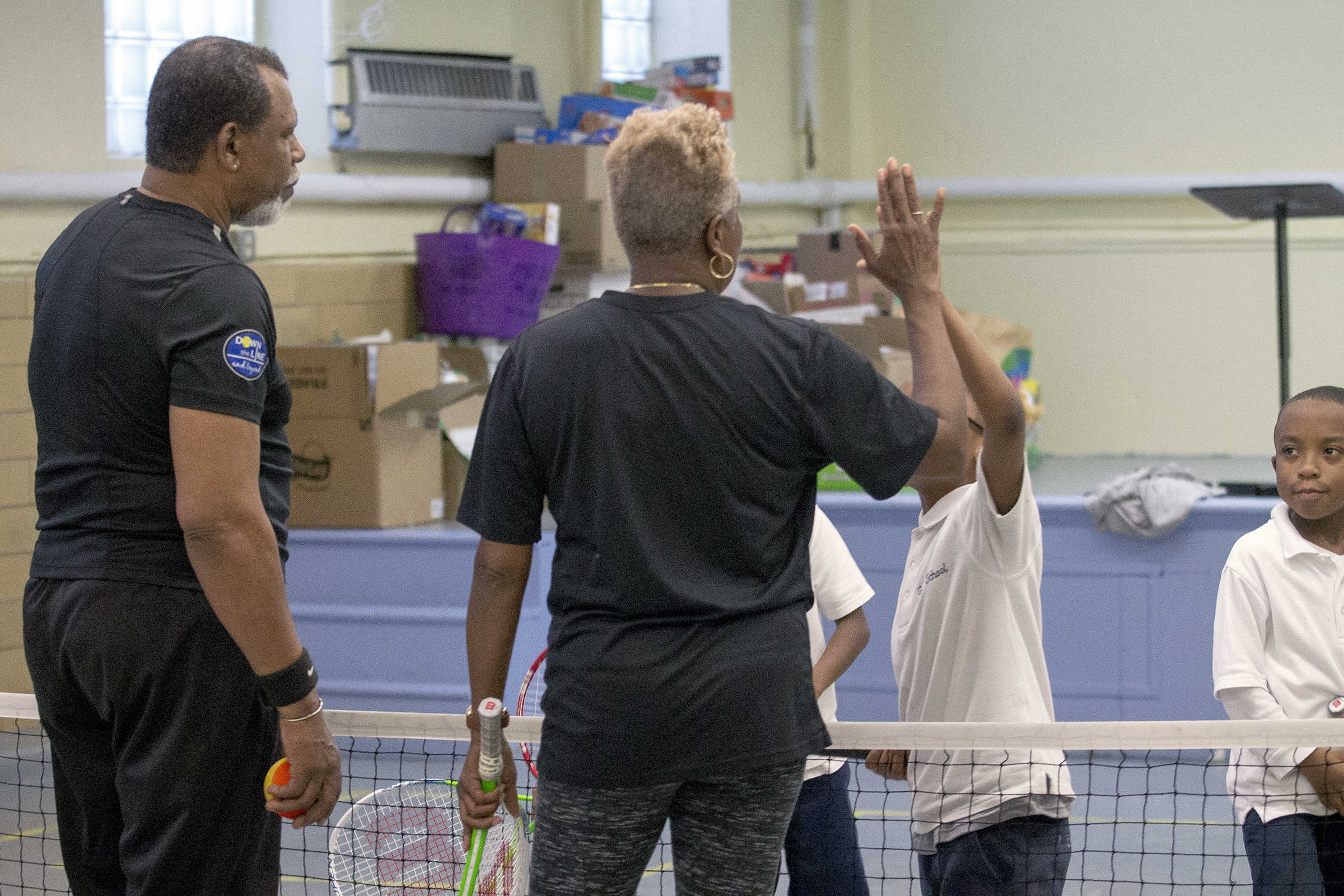 Retirees Kiwi Nicholson (left) and Cecelia Hodge (right) coaching kids in tennis on a Down The Line and Beyond tennis clinic in the Gesu School at 1700 W. Thompson St. in Philadelphia, April 4, 2017.