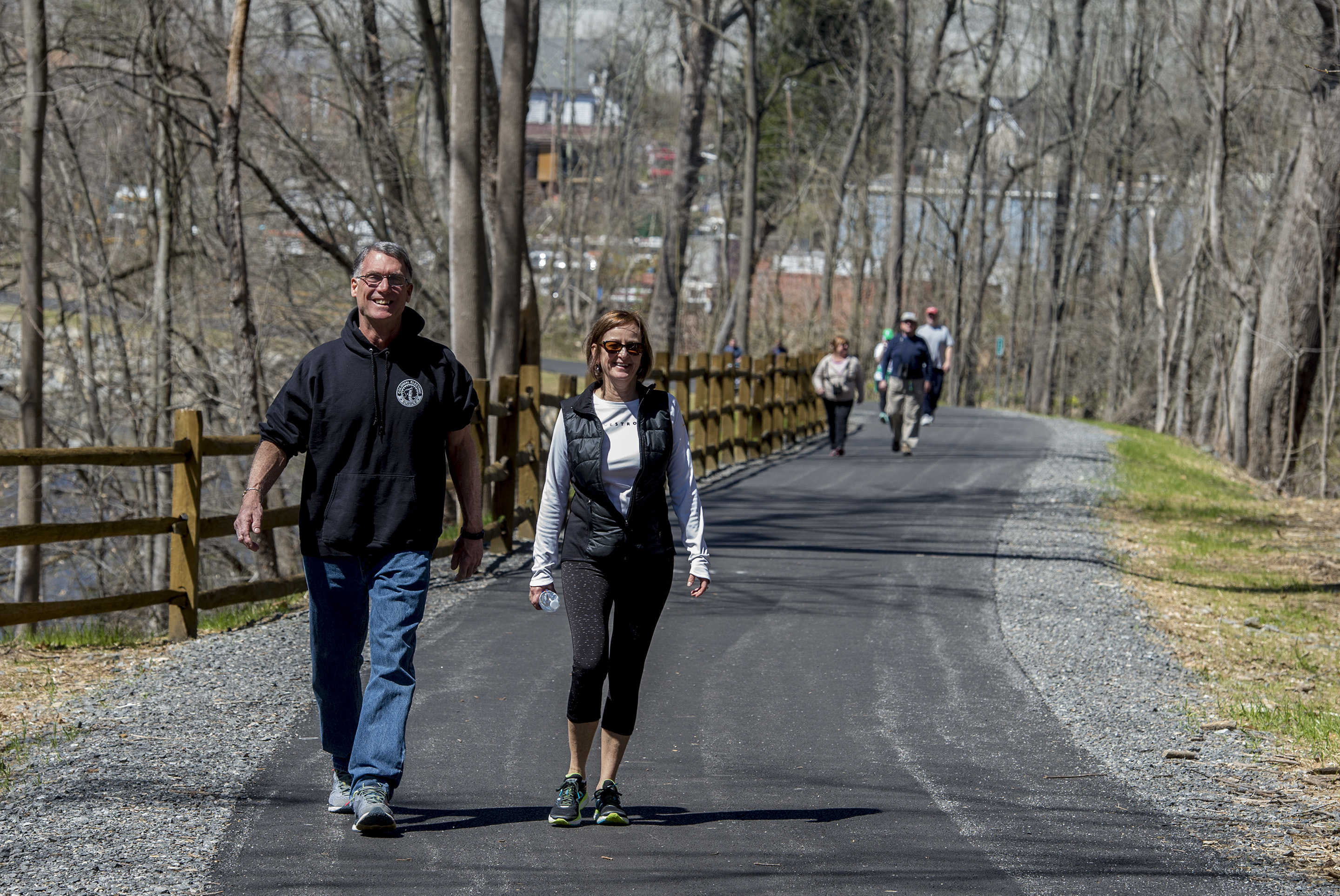Mike and Robin Salvatore, Garnet Valley, walk along the newly dedicated bike/walking path in Middletown, Delaware County April 9, 2017.